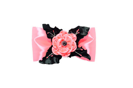 Kanzashi. Pink artificial flower on a bow isolated on white background