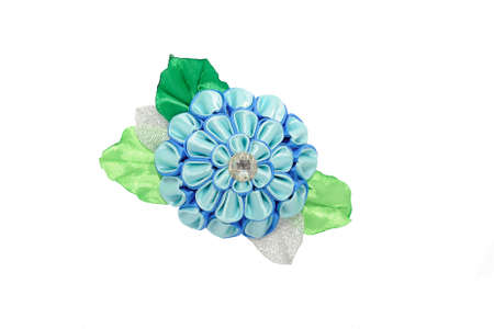 Kanzashi.Beautiful blue artificial flower with brocade, isolated on white background
