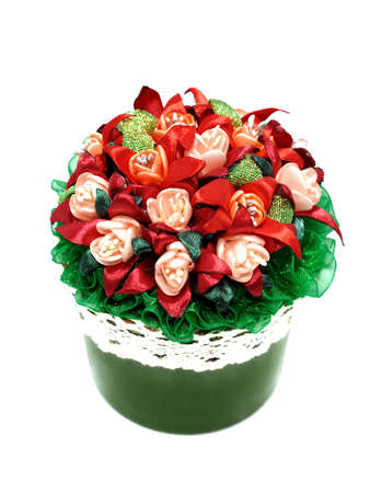 A bouquet of red flowers in a green pot isolated on white background