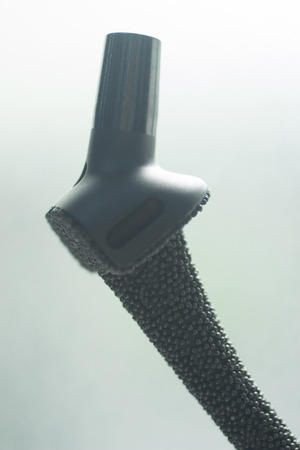titanium: Traumatology and orthopedic surgery titanium hip joint implant in semi silhouette against plain studio background.