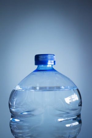 comp: Isolated plastic water bottle plain blue background studio shot close-up Royalty Free Stock Photo Find Similar Get a Comp Save to Lightbox Isolated plastic water bottle plain blue background studio shot close-up. Stock Photo