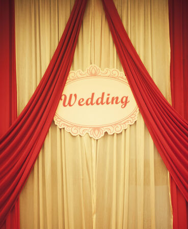 banqueting: Chinese traditional red wedding banqueting hall curtains with wedding sign in English language. Stock Photo