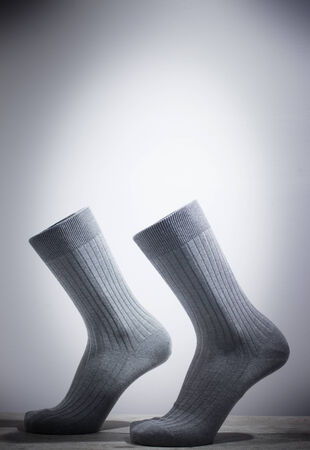 without legs: Surrealist socks and feet walking without legs attached.