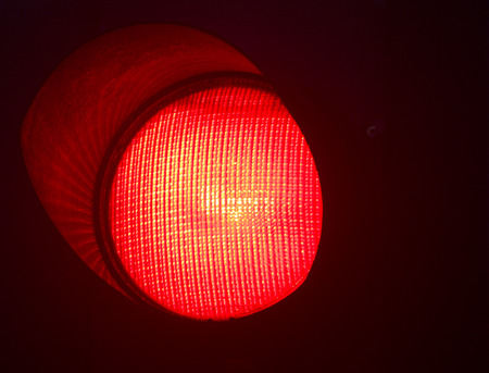 stop light: Traffic red stop light photo at night on black background. Stock Photo
