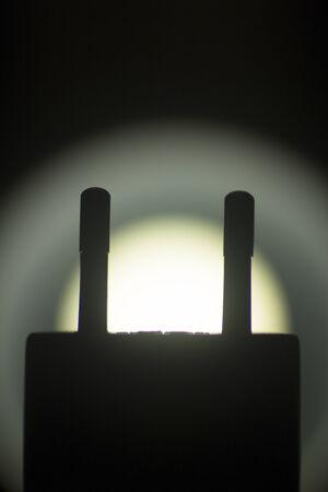 EU two pin plug artistic silhouette photograph. photo