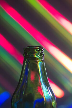 airtight: Bottle of beer and multicolor background photo.