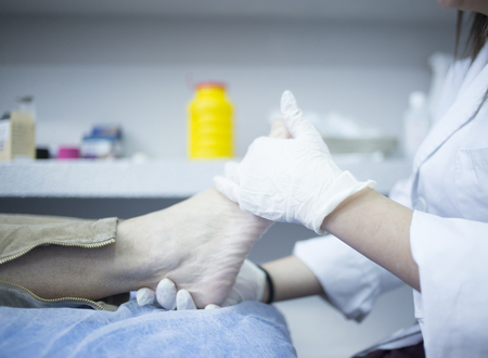 strains: Podology podologist examining patient with chiropody treatment used to treat foot pain, muscles injuries, strains and tension in hospital physiotherapy clinic medical examination.