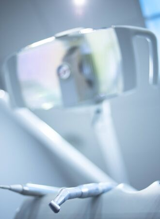 color photo: Dental instrumenation dentist light in denstists surgery clinic color photo in blue tones.