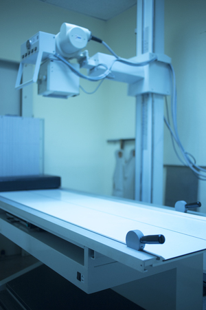 radiological: X-ray radiography scan machine in hospital clinic scanning room.