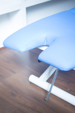 physiotherapists: Medical physiotherapy bed in a physiotherapists treatment area in hospital clinic. Stock Photo