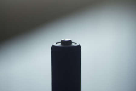 aaa: AAA Battery silhouette isolated photograph with light and dark effect.