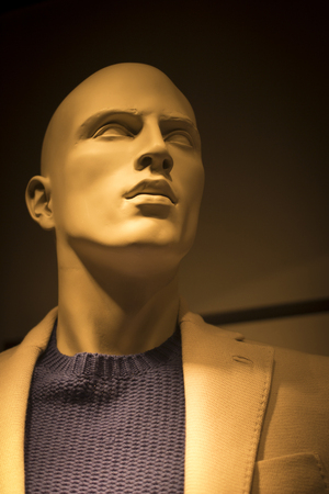surrealist: Male man shop dummy fashion mannequin in store boutique shop window at night photo.