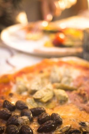 traditinal: Italian pizzeria traditinal wood fire oven pizza restaurant in Rome Italy. Stock Photo