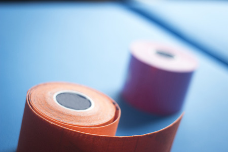 color therapist: Physiotape physiotherapy color tape bandage kinesiotape rolls for kinesiotaping taping treatment in real life hospital clinic. Stock Photo