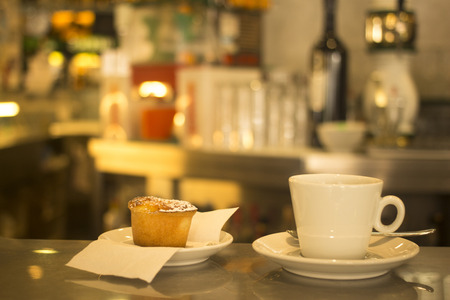 Italian coffee expresso cup spoon and saucer and Italian Budino traditional cake pastry dessert in restaurant cafe bar in Rome Italy.