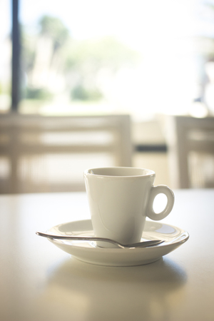 decaffeinated: Italian coffee expresso cup spoon and saucer in restaurant cafe bar in Rome Italy.