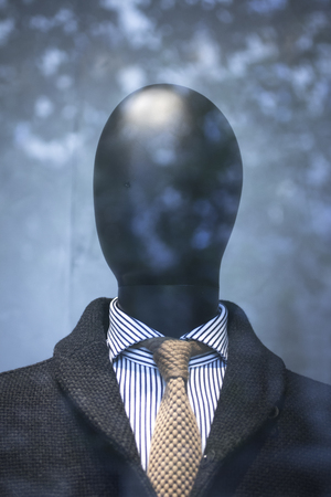 mens fashion: Shop male dummy mens fashion man in shirt and tie mannequin in store boutique shop window artistic photo. Stock Photo