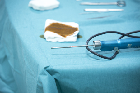 Traumatology orthopedic surgery hospital emergency operating room prepared for arthroscopy operation camera on table with equipment