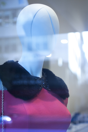 shop window: Shop dummy fashion mannequin in store boutique shop window artistic photo.