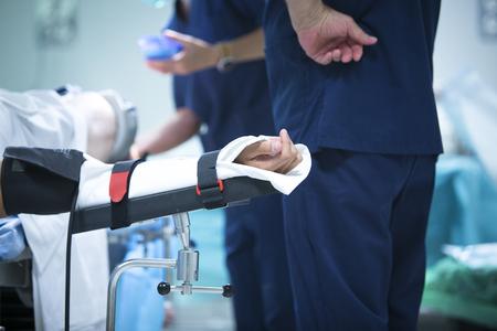 immobilize: Traumatology orthopedic surgery hospital emergency operating room prepared for arthroscopy operation photo of immobilized arm. Stock Photo