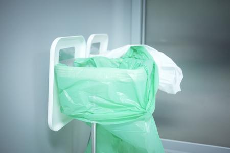 Traumatology orthopedic surgery hospital emergency operating room prepared for arthroscopy operation photo of trash can rubbish waste disposal bin plastic green bag. Stock Photo