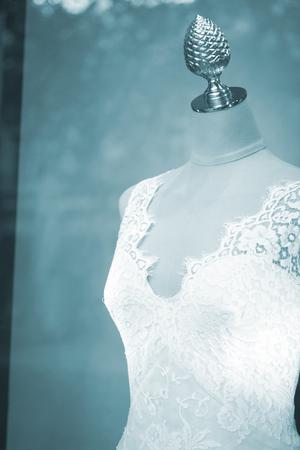 shop window: Shop bridal dummy bride fashion wedding mannequin in store boutique shop window artistic photo.