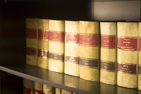 Old legal books Spanish barristers law reports in Spain on bookshelf in real life solicitors law attorneys office library.