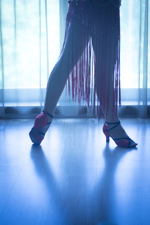 heel strap: Dancing shoes feet and legs of female ballroom and latin salsa dancer dance teacher in dance school rehearsal room class. Stock Photo
