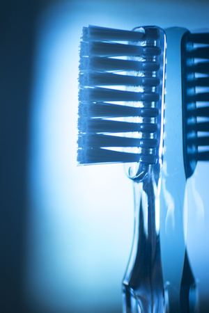 color photo: Toothbrush dental hygiene plaque control artistic teeth cleaning dental clinic dentists office surgery color photo in creative blue tones. Stock Photo