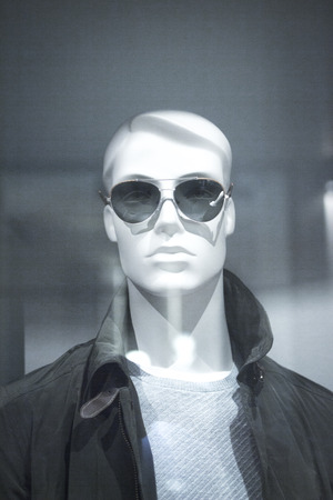 window shades: Shop dummy sunglasses fashion mannequin in store boutique glasses opticians shop window artistic photo.