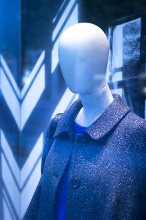 shop window: Shop bald dummy fashion mannequin in store boutique shop window artistic photo.