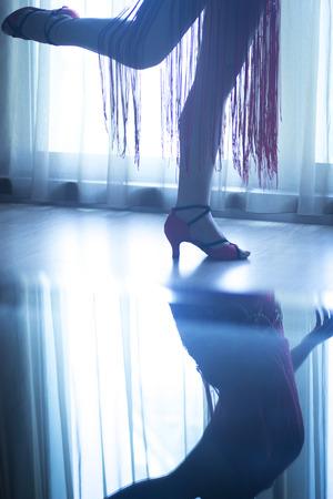 waltzing: Dancing shoes feet and legs of female ballroom and latin salsa dancer dance teacher in dance school rehearsal room class. Stock Photo