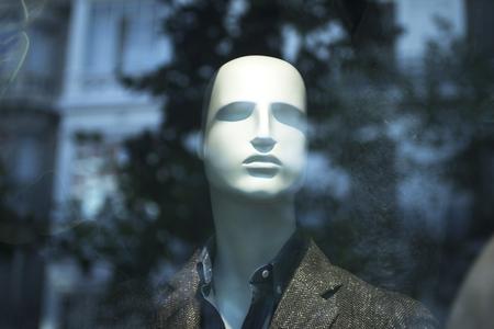 mens fashion: Shop male dummy mens fashion man mannequin in store boutique shop window artistic photo.