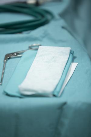 Traumatology orthopedic surgery hospital emergency operating room prepared for arthroscopy operation drapes sheets photo.