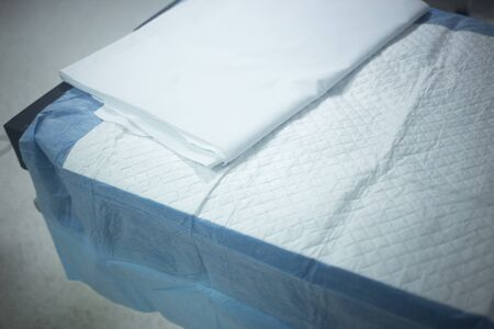 traumatology: Hospital bed in surgery traumatology clinic color photo in blue tones. Stock Photo