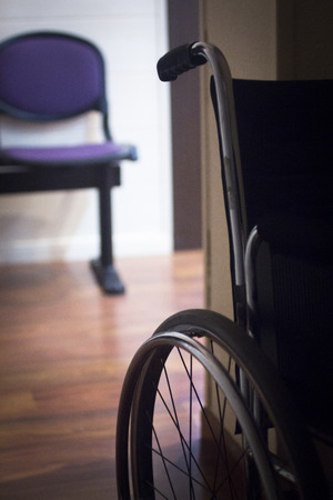 therapy equipment: Wheel chair in hospital clinic medical center waiting room.