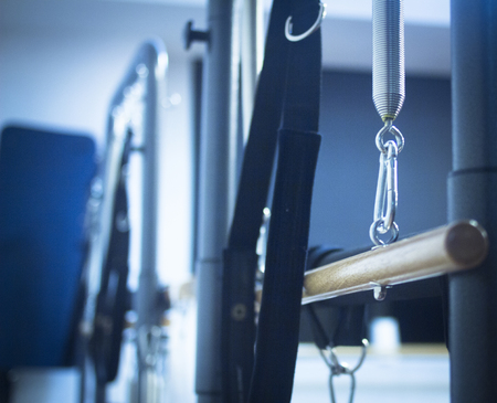 health club: Pilates exercise fitness gym machine in health club to develop strength, flexibility nd improve posture.