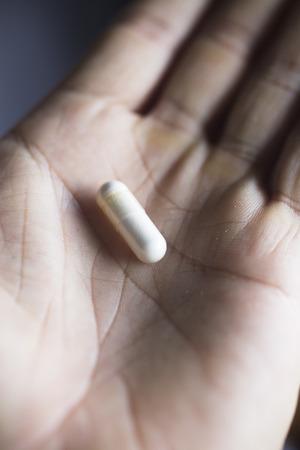 multivitamin: Multivitamin mineral pills health food supplements in hand of man.