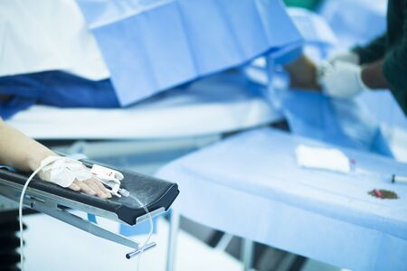 surgery bed: Patient hand immobilized in hospital emergency surgery emergency operating room medical clinic on hospital bed in real life photo.