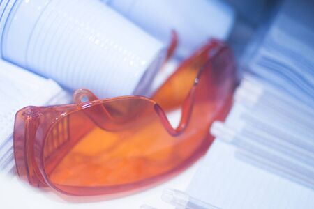protective glasses: Dental goggles protective glasses equipment in dentist office clinic surgery used to treat tooth decay, fillings, gum disease and orthodontics treatments.