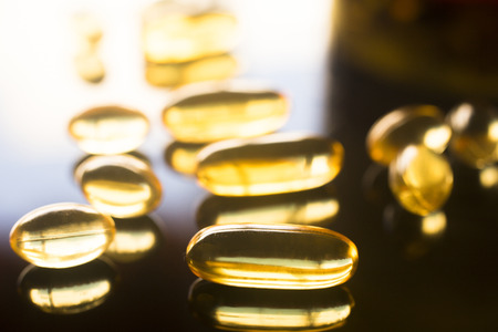 cod oil: Cod liver fish oil omega 3, 6 and 9 capsules health food supplements.