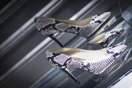 shop window: Shop window fashion store designer luxury leather shiny polished shoes.