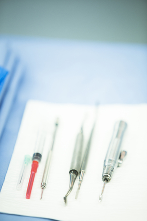 sterilized: Hospital emergency surgery operating room medical clinic instruments on sterilized table real life photo.