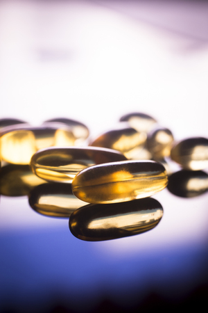 nutritional therapy: Cod liver fish oil omega 3, 6 and 9 capsules health food supplements.
