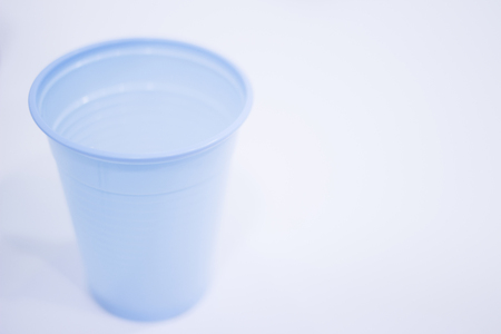 rinse: Dentists water rinse cup tap pip filler in dental clinic in artistic blue purple white tones. Stock Photo