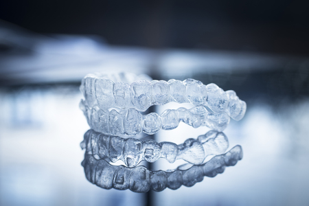 braces: Invisible dental teeth brackets tooth aligners plastic braces dentistry retainers to straighten teeth. Orthodontic temporary removable straighteners in dentist office dental surgery clinic.