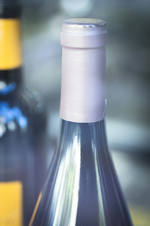 store window: Red wine bottle in retail store window display with lighting effect. Stock Photo