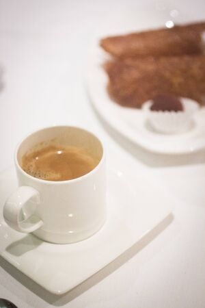 decaffeinated: Coffee expresso cup saucer in restaurant on table.