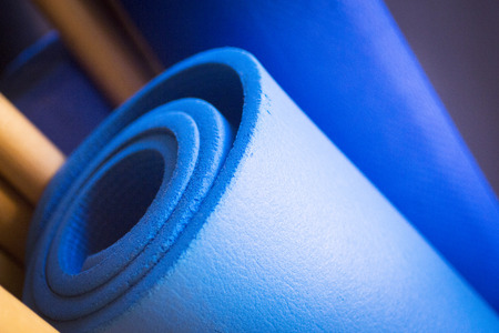 health club: Pilates exercise fitness gym training yoga mats and poles in health club to develop strength, flexibility and improve posture. Stock Photo
