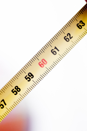 cm: Measuring tape metal ruler showing measuement in centimeters (cm) numbers on plain background Stock Photo